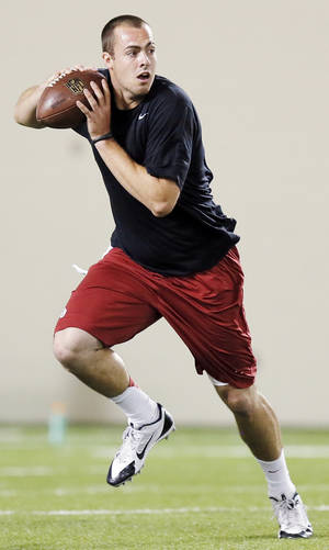 photo - Landry Jones rolls out during OU Pro Day, showcasing players' abilities for NFL football scouts, at the Everest Indoor Training Center on the campus of the University of Oklahoma in Norman, Okla., Wednesday, March 13, 2013. Photo by Nate Billings, The Oklahoman