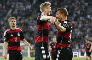 Photo - Germany's Thomas Mueller\, from left, Germany's Andre Schuerrle\ and Germany's Lukas Podoslki celebrate scoring during a friendly WCup preparation soccer match between Germany and Cameroon in Moenchengladbach, Germany, Monday, June 2, 2014. (AP Photo/Frank Augstein)