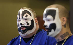 Photo - FILE --In this Jan. 8, 2014 file photo, Joseph Bruce, aka Violent J, left, and Joseph Utsler, aka Shaggy 2 Dope, members of the Insane Clown Posse, address the media in Detroit. The U.S. Justice Department is asking a judge to dismiss a lawsuit by Insane Clown Posse, which objects to a report that describes its fans as a dangerous gang. A Detroit federal judge holds a hearing Monday, June 23, 2014. The government says the rap-metal duo from the Detroit area and its fans have no standing to sue. (AP Photo/Carlos Osorio)