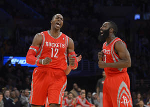 Photo - Houston Rockets center Dwight Howard, left, and guard James Harden reacts after Howard was called for a technical foul during the first half of an NBA basketball game against the Los Angeles Lakers, Wednesday, Feb. 19, 2014, in Los Angeles. (AP Photo/Mark J. Terrill)