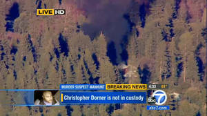 Photo - In this image taken from video provided by KABC-TV, the cabin in Big Bear, Calif. where ex-Los Angeles police officer Christopher Dorner is believed to be barricaded inside is in flames Tuesday, Feb. 12, 2013. (AP Photo/KABC-TV) MANDATORY CREDIT: KABC-TV