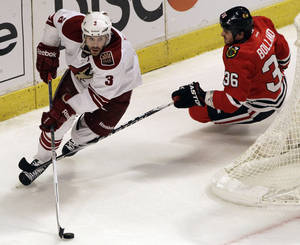 Photo -   Phoenix Coyotes' Keith Yandle (3) controls the puck against Chicago Blackhawks' Dave Bolland (36) during the third period of Game 6 of an NHL hockey Stanley Cup first-round playoff series in Chicago, Monday, April 23, 2012. The Coyotes won 4-0. (AP Photo/Nam Y. Huh)
