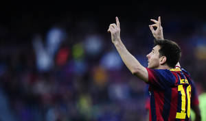 Photo - FC Barcelona's Lionel Messi, celebrates after scoring during the Spanish La Liga soccer match between FC Barcelona and Osasuna at the Camp Nou stadium in Barcelona, Spain, Sunday, March 16, 2014. (AP Photo/Manu Fernandez)