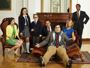 Photo - 1600 PENN -- Season: Pilot -- Pictured: (l-r) Martha MacIsaac as Becca, Amara Miller as Marigold, Benjamin Stockham as Xander, Bill Pullman as Dale, Josh Gad as Skip, Jenna Elfman as Emily, Andre Holland as Marshall Malloy -- (Photo by: Chris Haston/NBC)