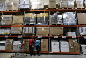 Photo - In this June 4, 2014 photo, shoppers look at washers and dryers at a Costco in Plano, Texas. The Commerce Department releases business inventories for April on Thursday, June 12, 2014. (AP Photo/LM Otero)