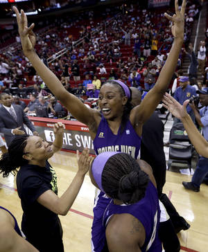 Photo - Prairie View A&M's LaReahn Washington, rear, celebrates as she is lifted up by Shamiya Brooks after their team beat Texas Southern 63-58 in an NCAA college basketball game in the championship of the Southwestern Athletic Conference tournament Saturday, March 15, 2014, in Houston.  (AP Photo/David J. Phillip)