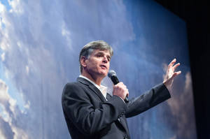 "Photo - Political commentator Sean Hannity addresses the crowd while delivering his speech, ""Get America Back to Work"", Thursday, May 22, 2014, during the 22nd Williston Basin Petroleum Conference held in Bismarck, N.D. (AP Photo/Kevin Cederstrom)"