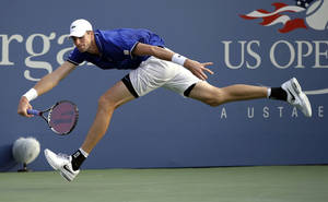 Photo - John Isner chases down a ball to return to Philipp Kohlschreiber, of Germany, during the third round of the 2013 U.S. Open tennis tournament, Saturday, Aug. 31, 2013, in New York. (AP Photo/Darron Cummings)