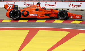 Photo - Simon Pagenaud, of France, drives through Turn 2 during a practice session for the IndyCar Grand Prix of Houston auto race Friday, June 27, 2014, in Houston. (AP Photo/David J. Phillip)
