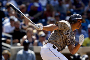 Photo -   San Diego Padres' Will Venable watches his run-producing single against the Colorado Rockies during the seventh inning of the Padres' 3-2 victory in a baseball game on Sunday, July 22, 2012, in San Diego. (AP Photo/Lenny Ignelzi)