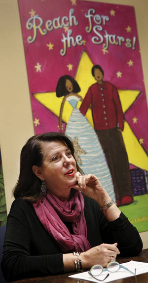 photo - Debbie Forshee,  president and CEO of the Community Intervention Center, discusses the centers purpose and mission Wednesday in her office.