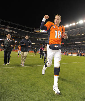photo -   Denver Broncos quarterback Peyton Manning (18) reacts as he runs off the field after the Broncos defeated the New Orleans Saints 34-14 in an NFL football game, Sunday, Oct. 28, 2012, in Denver. (AP Photo/Jack Dempsey)