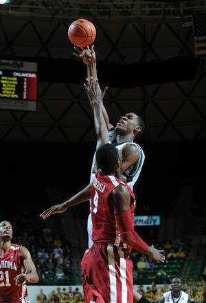 Photo - Baylor's Perry Jones, right, shoots over Oklahoma's Andrew Fitzgerald during the Bears' 74-61 win Tuesday. PHOTO BY ROD AYDELOTTE, WACO TRIBUNE HERALD