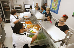 photo - Fifth-graders go through the serving line at lunch at Wilson Elementary School in Oklahoma City. New federal rules have changed lunch menus nationwide. PHOTOS BY  PAUL B. SOUTHERLAND, THE OKLAHOMAN