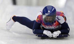 Photo - Elizabeth Yarnold of Great Britain brakes in the finish area after her first run during the women's skeleton competition at the 2014 Winter Olympics, Thursday, Feb. 13, 2014, in Krasnaya Polyana, Russia. (AP Photo/Natacha Pisarenko)