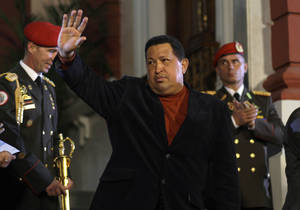Photo -   Venezuela's President Hugo Chavez waves after an impromptu news conference with the foreign press at Miraflores palace in Caracas, Venezuela, Saturday, Oct. 6, 2012. Chavez is running for re-election against opposition candidate Henrique Capriles in Sunday's presidential election. (AP Photo/Ramon Espinosa)