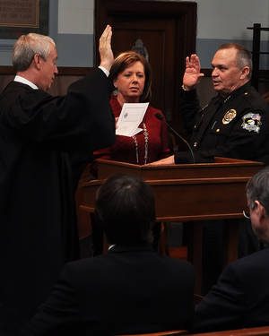 Photo - Oklahoma County Sheriff John Whetsel is sworn in Wednesday by District Judge Jerry Bass as his wife, Mitzi, watches. Photos provided