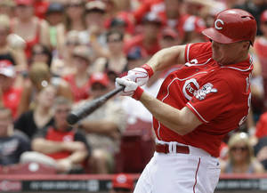 Photo - Cincinnati Reds' Jay Bruce hits a two-run home run off Milwaukee Brewers relief pitcher Will Smith in the eighth inning of a baseball game, Sunday, July 6, 2014, in Cincinnati. Cincinnati won 4-2. (AP Photo/Al Behrman)