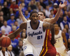 Photo - FILE - In this Jan. 29, 2014 file photo, Kansas center Joel Embiid (21) works around Iowa State forward Georges Niang, back, during the first half of an NCAA college basketball game in Lawrence, Kan. Embiid's hope of being the No. 1 pick in the 2014 NBA Draft is almost certainly gone now because of his foot injury.(AP Photo/Orlin Wagner, File)