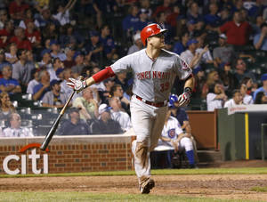 Photo - Cincinnati Reds catcher Devin Mesoraco tosses his bat aside and watches his grand slam home run off Chicago Cubs relief pitcher Hector Rondon, also scoring Todd Frazier, Billy Hamilton and Joey Votto, during the ninth inning of a baseball game Monday, June 23, 2014, in Chicago. The Reds won 6-1. (AP Photo/Charles Rex Arbogast)