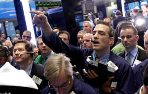 Photo - Trader Gregory Rowe calls out an order on the floor of the New York Stock Exchange Friday, April 19, 2013. The broad Standard & Poor's 500 index opened higher early Friday.  (AP Photo/Richard Drew)