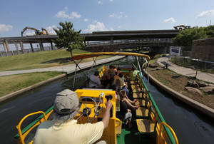 Photo - Dale German leads a tour through the Bricktown Canal, Friday, July 13, 2012.  The south part of the canal will be closed for the demolition of the I-40 bridge.  Photo by Garett Fisbeck, The Oklahoman