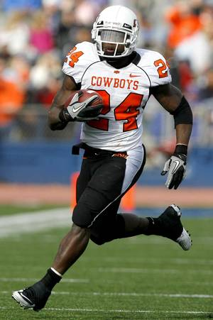 Photo - Oklahoma State's Kendall Hunter (24) runs up field during the college football game between Oklahoma State (OSU) and Kansas (KU), Saturday, Nov. 20, 2010 at Memorial Stadium in Lawrence, Kan. Photo by Sarah Phipps, The Oklahoman