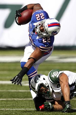 Photo -   Buffalo Bills running back Fred Jackson is hit by New York Jets defensive back LaRon Landry during the first half of an NFL football game at MetLife Stadium, Sunday, Sept. 9, 2012, in East Rutherford, N.J. Jackson was injured on the play. (AP Photo/Mel Evans)