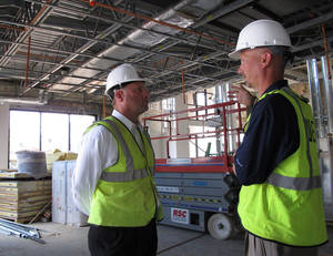 photo - Texarkana, Texas, mayor Bob Bruggeman, left, talks to a developer at the site of a convention center and hotel being built on the Texas side of the sister cities on the Texas-Arkansas border. The competition between Texarkana, Texas, and Texarkana, Ark., has grown and when one state decided to build a convention center in one town, the other side made plans to erect one, too — even though the two facilities are just a few miles apart. AP Photo