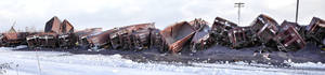 Photo - A Canadian National Railway train filled with iron ore pellets from the Iron Range derailed in Two Harbors early Thursday, Dec. 5, 2013 and two injuries were reported The accident occurred at 1:14 p.m. on a bend in the tracks between Northshore Manufacturing and Two Harbors Lumber on Fourth Avenue in Two Harbors in an area that is considered the CN train yard. (AP Photo/The Duluth News Tribune , Clint Austin)