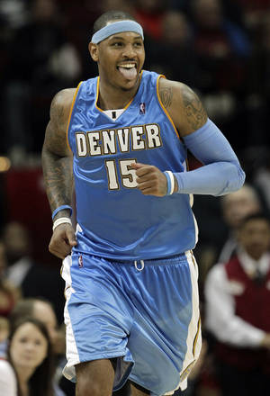 photo - The New Jersey Nets are working to acquire Carmelo Anthony, sources told the Associated Press. AP PHOTO