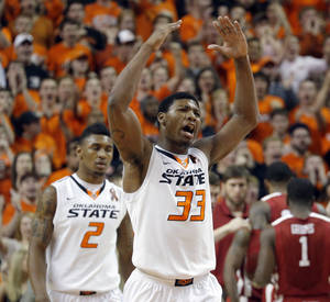 photo - Oklahoma State's Marcus Smart (33) celebrates during the Bedlam men's college basketball game between the Oklahoma State University Cowboys and the University of Oklahoma Sooners at Gallagher-Iba Arena in Stillwater, Okla., Saturday, Feb. 16, 2013. Photo by Sarah Phipps, The Oklahoman