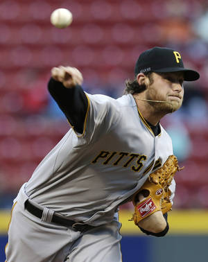 Photo - Pittsburgh Pirates starting pitcher Gerrit Cole throws against the Cincinnati Reds in the first inning of a baseball game, Tuesday, April 15, 2014, in Cincinnati. (AP Photo/Al Behrman)