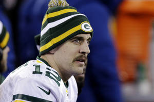 Photo -   Green Bay Packers' Aaron Rodgers watches his team play during the second half of an NFL football game against the New York Giants, Sunday, Nov. 25, 2012, in East Rutherford, N.J. (AP Photo/Kathy Willens)