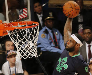 Photo - East Team's LeBron James, of the Miami Heat (6) heads to the hoop during the NBA All Star basketball game, Sunday, Feb. 16, 2014, in New Orleans. (AP Photo/Bill Haber)