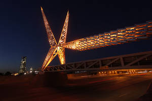 photo - The SkyDance Bridge is lighted at night. OKLAHOMAN ARCHIVE PHOTO BY DOUG HOKE <strong>DOUG HOKE</strong>