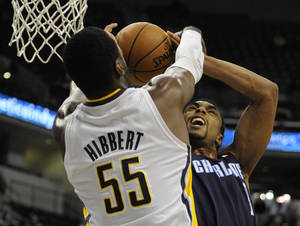 Photo - Charlotte Bobcats guard Gerald Henderson, right, shoots over Indiana Pacers center Roy Hibbert (55) in the first half of an NBA basketball game in Indianapolis, Wednesday, Feb. 13, 2013. (AP Photo/ Alan Petersime)