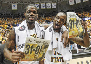 Photo - Wichita State's Chadrack Lufile, left, and Nick Wiggins celebrate their perfect 31-0 season after defeating Missouri State 68-45 in an NCAA college basketball game in Wichita, Kan., Saturday, March 1, 2014.  (AP Photo/The Wichita Eagle, Fernando Salazar) LOCAL TV OUT; MAGS OUT; LOCAL RADIO OUT; LOCAL INTERNET OUT