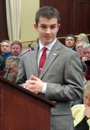 "Photo - Domenic Gelsomino, a Boise State University student and head of the Federation of Idaho College Republicans, testifies against Gov. C.L. "" Butch"" Otter's proposed state-designed insurance exchange on Tuesday, Feb. 5, 2013 in the Capitol in Boise, Idaho. (AP Photo/John Miller)"