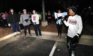 Photo - Maurice Lee, president of the Oklahoma Landrunners Club, organizes runners before their training run at Lake Hefner trail in Oklahoma City, OK, Saturday, February 1, 2014,  Photo by Paul Hellstern, The Oklahoman