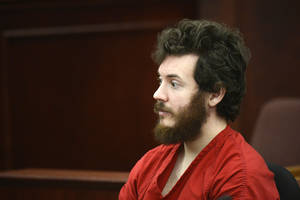Photo - FILE - This March 12, 2013 file photo shows James Holmes, Aurora theater shooting suspect, in the courtroom during his arraignment in Centennial, Colo. Lawyers for Holmes are objecting to a Fox News reporter's request to delay her court appearance to testify about her confidential sources, Tuesday, March 27, 2013. (AP Photo/Denver Post, RJ Sangosti, Pool)