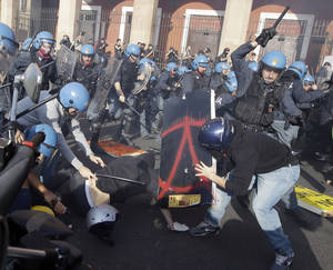 Photo -   Police clash with demonstrators during a protest against Italian Government austerity measures in Rome, Wednesday, Nov. 14, 2012. Workers across the European Union sought to present a united front against rampant unemployment and government spending cuts Wednesday with a string of strikes and demonstrations across the region. Protesters clashed with police in various demonstrations in Rome, Milan, Turin, Padua and Brescia. (AP Photo/Gregorio Borgia)