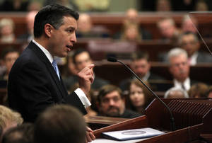 photo - Nevada Gov. Brian Sandoval delivers the State of the State address at the Legislature in Carson City, Nev., on Wednesday, Jan. 16, 2013. (AP Photo/Cathleen Allison)