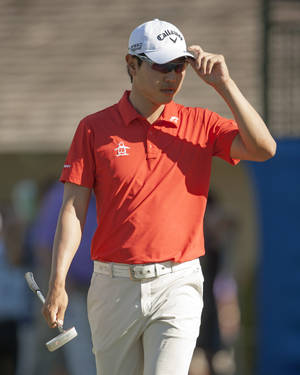 Photo - Sang-Moon Bae, of South Korea, tips his cap to the gallery on the ninth green during the first round of the Sony Open golf tournament on Thursday, Jan. 9, 2014, in Honolulu. (AP Photo/Marco Garcia)