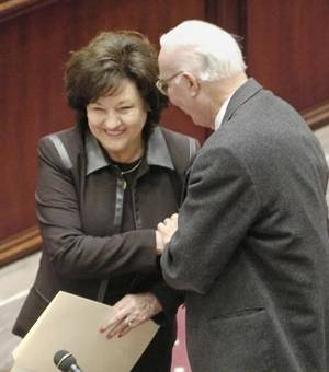 Photo - In this 2004 file photo Sen. Mary  Easley is congratulated by fellow senator, Assistant Majority Leader Gilmer Capps, after Easley was sworn in as a state senator. Staff photo by Jim Beckel