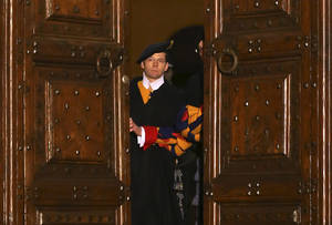 "photo - Vatican Swiss guards close the main door of the papal residence in Castel Gandolfo, south of Rome, Thursday, Feb. 28, 2013. Benedict XVI greeted the faithful for the last time as pope on Thursday, telling tearful well-wishers that he is beginning the final stage of his life as ""simply a pilgrim,"" hours before he becomes the first pontiff in 600 years to resign. (AP Photo/Luca Bruno)"