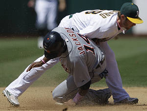 photo -   Detroit Tigers&#039; Austin Jackson steals second base beneath the tag of Oakland Athletics second baseman Eric Sogard during the fifth inning of a baseball game Sunday, May 13, 2012, in Oakland, Calif. (AP Photo/Ben Margot)  