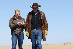 """Photo - This undated publicity image released by A&E shows Katee Sackhoff , left, and Robert Taylor in the series """"Longmire,"""" returning for a second season on Monday, May 27 at 10 p.m. on A&E. (AP Photo/A&E, Ursula Coyote)"""