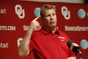 Photo - COLLEGE FOOTBALL / MUG: Associate head coach Mike Stoops addresses the media during media access day for the University of Oklahoma Sooner (OU) football team in the Adrian Peterson meeting room inside Gaylord Family-Oklahoma Memorial Stadium in Norman, Okla., on Saturday, Aug. 3, 2013. Photo by Steve Sisney, The Oklahoman