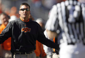 Photo - OSU head coach Mike Gundy argues a call during the college football game between the Oklahoma State University Cowboys (OSU) and the Baylor University Bears at Boone Pickens Stadium in Stillwater, Okla., Saturday, Nov. 6, 2010. Photo by Sarah Phipps, The Oklahoman